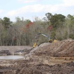 Billy Augustine Jr. excavates a pond for a new planting site.