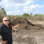 Bill looks over the topsoil